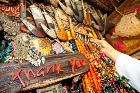 souk: Words thank you written on board, with hand and jewelery in background  Today, suk in Muscat is one of the most beautiful Arab markets  Stock Photo