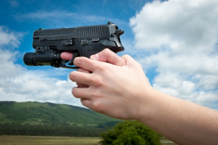 Girl holding gun in nature