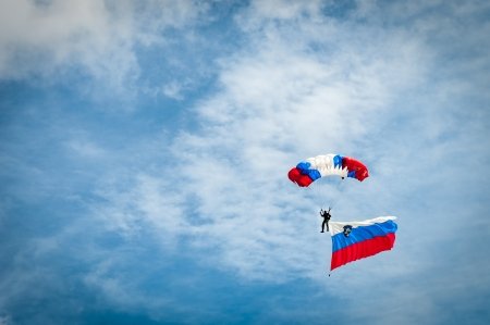 Skydiver with Slovenian flag, parachute in colors of Slovenian flag