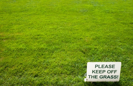 Please keep of the grass lettering sign, on green