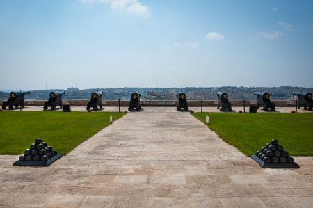 Salting Battery with old cannons and cannonballs, on Valletta Castle, Malta