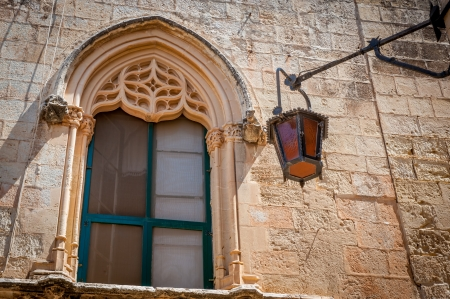 Medivial architectured window with old light in Mdina, Malta Stock Photo
