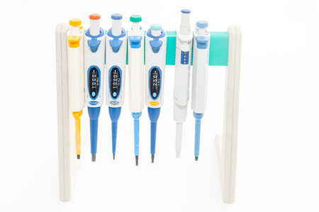 Colorful medical droppers, pipettes, isolated on white  Stock Photo