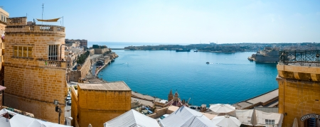 Panorama of Valletta bay, Malta, with parts of castle and blue sea Stock Photo