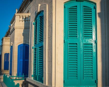 Turquoise and blue wooden door shutters street