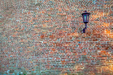 Lantern on a wall with bricks, pattern