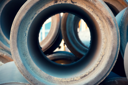 Empty and unused sewage pipes close up, pattern and industry background