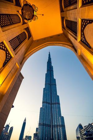 DUBAI, UAE - FEBRUARY 27, 2016: Burj Khalifa, view through entrance of Dubai market, at evening