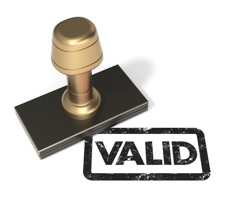 valid: Close up of rubber stamp Valid on isolated white background  Stock Photo