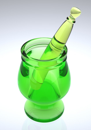 pestle: Green glass mortar and pestle. Stock Photo