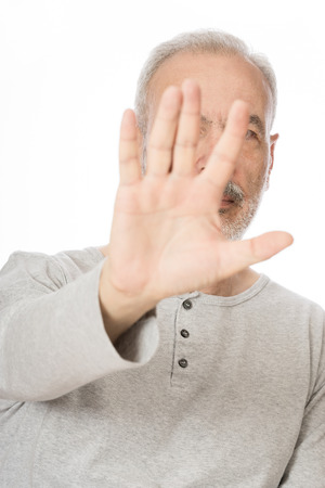 barring: Old Man Blocking the Camera, Over White Background