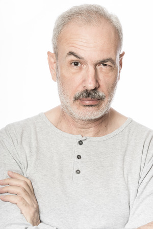 eyebrow raised: Man with raised eyebrow, over white background Stock Photo