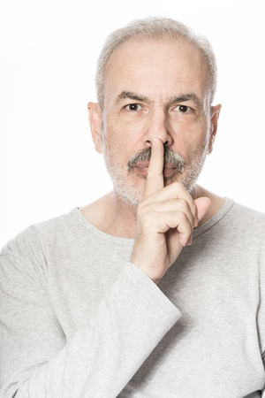 shush: Old Man with Finger on Lips Keeping a Secret
