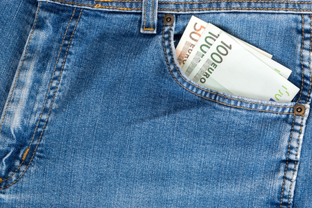 one hundred euro banknote: Close-up of one hundred Euro banknote in jeans pocket.