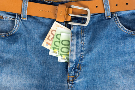 zipped: Close-up of one hundred and fifty Euro banknote in jeans zipped.