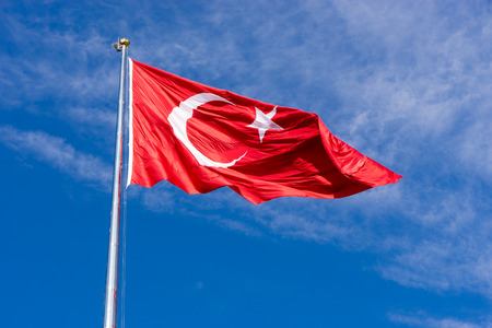 Turkish flag waving in blue sky, Izmir, TURKEY