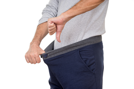 A guy not being to happy with what he finds in his pants Stock Photo - 56578334