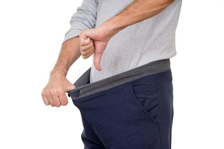 Een man het niet om gelukkig te zijn met wat hij vindt in zijn broek
