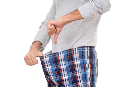 Een man het niet om gelukkig te zijn met wat hij vindt in zijn boxershort