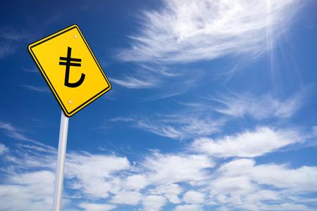 lira: Yellow Road Sign with Turkish Lira Sign Inside on Blue Sky Background Stock Photo