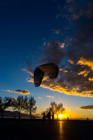 Silhouette skydiver parachutist training at sunset Stock Photo