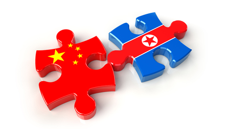 China and North Korea flags on puzzle pieces. Political relationship concept. 3D rendering Stock Photo
