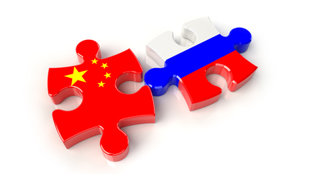 China and Russia flags on puzzle pieces. Political relationship concept. 3D rendering Stock Photo