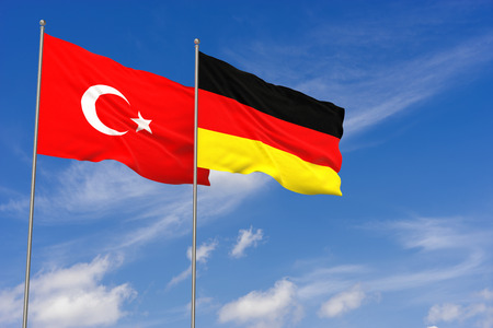 Turkey and Germany flags over blue sky background. 3D illustration Stock Illustration - 103432460