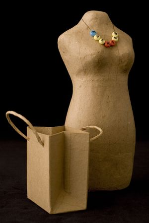 mannequin, paper bag and beads photo