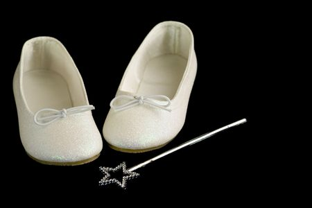 cinderella shoes: Slippers and magic wand on a black background