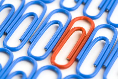Paper clips on a white background photo