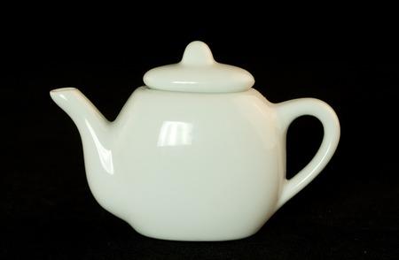 teapot. Black background. photo