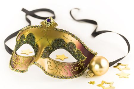 costume ball: Carnival mask and Christmas decorations on white background