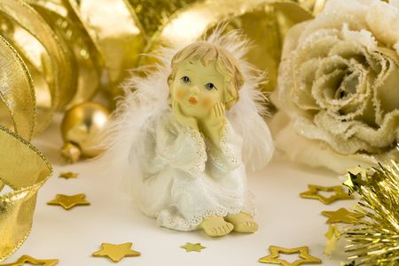Little angel and Christmas decorations photo