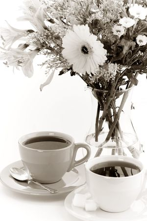 the fruitful: Two cups of tea and flowers. Sepia tonned.