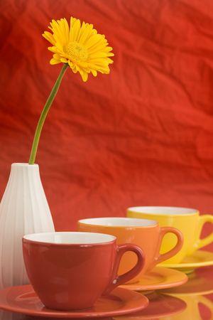 Row of color cups and beautiful yellow gerbera. Selective focus. Stock Photo - 2585709