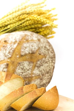 fresh baked bread sliced and grains over white background photo