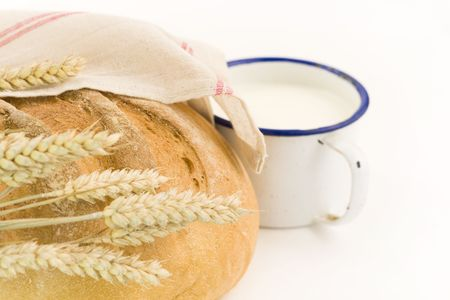 bread and milk composition on white background photo