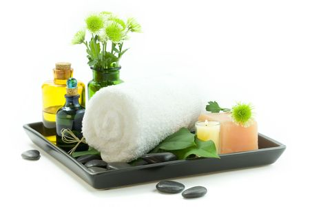 usage: relaxation spa set with candles, essential oils, towel, pebbles and fresh flowers, suited for spa and healthy lifestyle usage