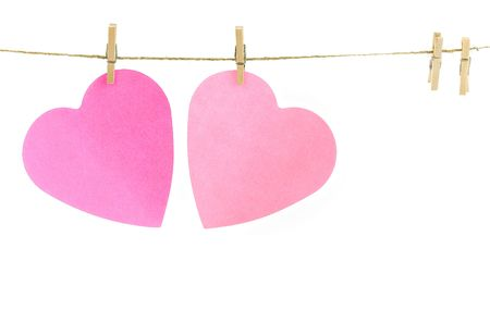 Pink paper hearts on a clothes line. White background. Valentine concept photo