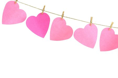 Pink paper hearts on a clothes line. White background. Valentine concept Stock Photo - 3657334