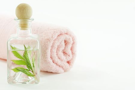 traquility: Jar with fresh leaves and towel (SPA concept)