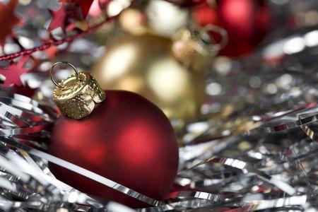 Red christmas ball and christmas decorations. Selective focus photo