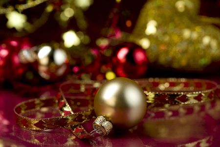 Gold Christmas ball in the center of Christmas decorations. Selective focus   photo