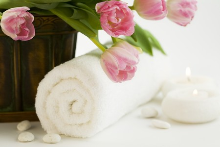 retreats: spa feeling (flowers, candle and towel). White background