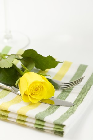 place to shine: Fresh yellow rose, fork and flower. Healthy food concept