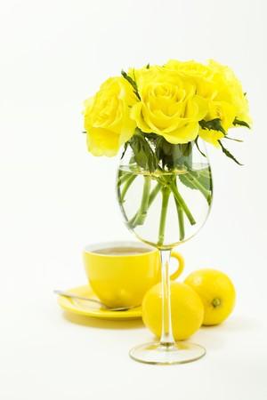 Cup of hot tea, lemons and beautiful roses photo