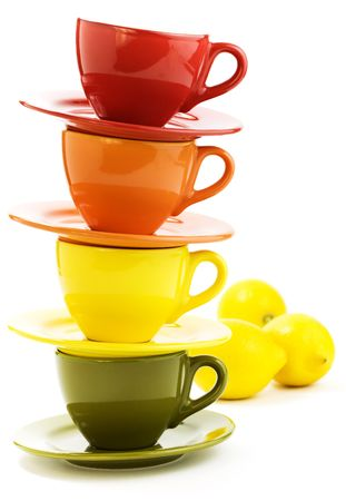 Color cups and lemons an white background photo
