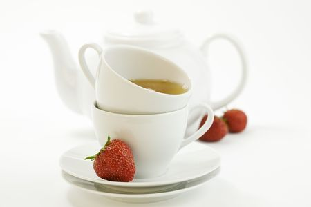 strawberry, white teacup with hot tea and teapot on white background Stock Photo - 4914458