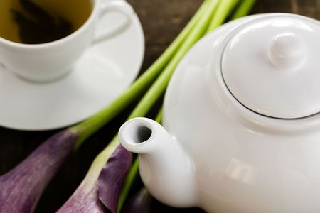 tea set with green tea on a wooden surface with a purple flowers Stock Photo - 4914473